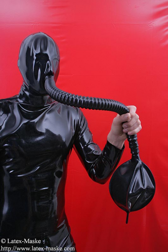 Mask with zip-fastener, latex tube and breath bag